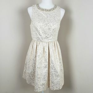 Cooperative gold and cream dress.